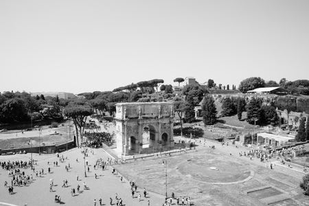Rome, Italy - June 20, 2018: Triumphal Arch of Constantine in Rome, situated between the Colosseum and the Palatine Hill