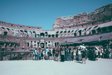 Rome, Italy - June 20, 2018: Panoramic view of interior of Colosseum in Rome. Summer day with blue and sunny sky