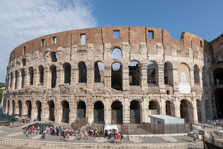 Rome, Italy - June 20, 2018: Panoramic view of exterior of Colosseum in Rome. Summer day with blue and sunny sky