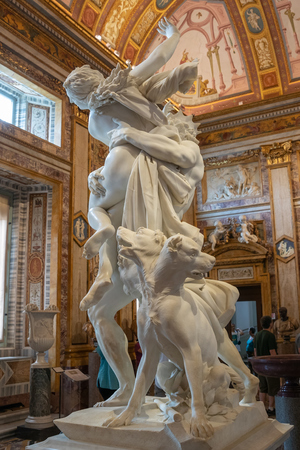 Rome, Italy - June 22, 2018: Baroque marble sculpture Rape of Proserpine by Bernini 1621 in Galleria Borghese of Villa Borghese
