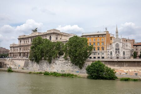 Panoramic view of city Rome with river Tiber and old church on other coast. Summer day and dramatic blue sky Reklamní fotografie