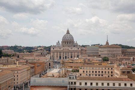 Rome, Italy - June 22, 2018: Panoramic view on the Papal Basilica of St. Peter (St. Peter's Basilica) in the Vatican and city of Rome. Summer day and dramatic sky