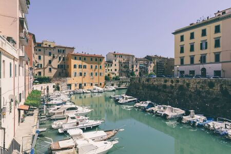Livorno, Italy - June 29, 2018: Panoramic view of historic buildings of Lovorno with water canal and boats