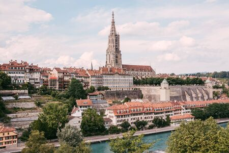 Panoramic view on Bern Minster and historic old town of Bern in Switzerland. Summer landscape, sunny day and blue sky Stock Photo