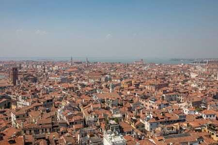Panoramic view of Venice city with historic buildings from St. Mark's Campanile. Landscape of summer day and sunny blue sky