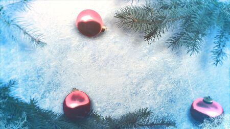 Closeup red balls and Christmas green tree branches on shiny ice background. Luxury and elegant dynamic style 3D illustration for winter holiday