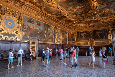 Venice, Italy - June 30, 2018: Panoramic view of hall interior and arts in Doge's Palace (Palazzo Ducale) is a palace built in Venetian Gothic style on Piazza San Marco