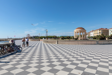 Livorno, Italy - June 29, 2018: Panoramic view of Terrazza Mascagni (Mascagni terrace) in front of the Ligurian sea on the western coast of Tuscany in Livorno. People walk and rest on terrace Editorial