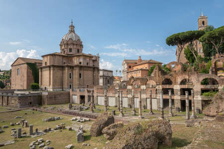 Rome, Italy - June 23, 2018: Panoramic view of forum of Caesar also known as forum Iulium, Curia Julia (Senate House) and church Santi Luca e Martina