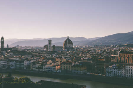 Panoramic view of Florence city with Cattedrale di Santa Maria del Fiore and Palazzo Vecchio from Piazzale Michelangelo (Michelangelo Square). Summer sunny day and dramatic blue sky Imagens