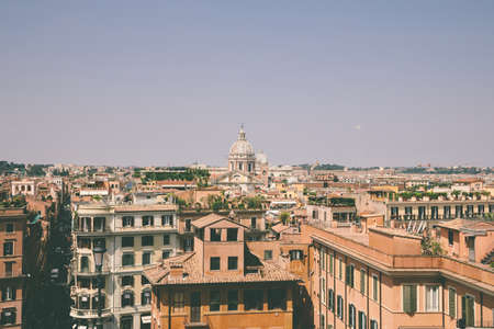 Panoramic view of city Rome with old houses from the Spanish steps. Summer sunny day and blue sky Imagens