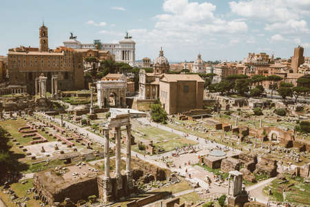 Panoramic view of Roman forum, also known by Forum Romanum or Foro Romano from Palatine Hill. It is a forum surrounded by ruins of ancient government buildings at center of city of Rome