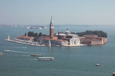 Panoramic view of San Giorgio Maggiore Island from St. Mark's Campanile. Landscape of summer day and sunny blue sky Imagens