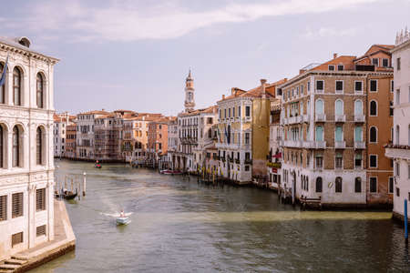 Venice, Italy - July 1, 2018: Panoramic view of Grand Canal (Canal Grande) from Rialto Bridge. It is a major water-traffic corridors in Venice city. Landscape of summer sunny day and blue sky
