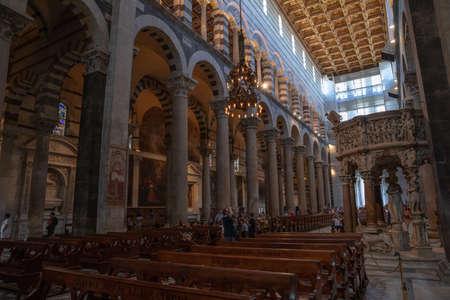 Pisa, Italy - June 29, 2018: Panoramic view of interior of Pisa Cathedral (Cattedrale Metropolitana Primaziale di Santa Maria Assunta) is a medieval Roman Catholic cathedral