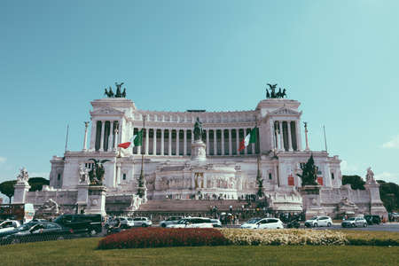 Rome, Italy - July 3, 2018: : Panoramic front view of museum the Vittorio Emanuele II Monument also known as the Vittoriano or Altare della Patria at Piazza Venezia in Rome. Summer day and blue sky