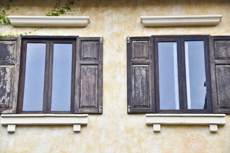 Italian style building with twin windows. photo