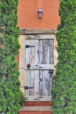 Wooden door of Italian style home. photo