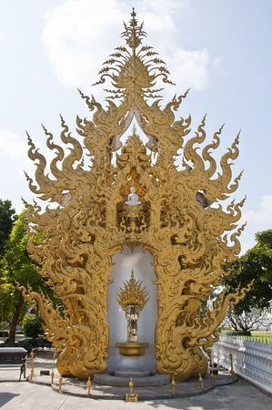 Golden arch in white temple, Thailand. photo