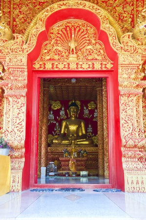 Golden Buddha in golden arch.