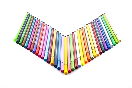 Colorful marker pens line up in v shape row isolate Stock Photo - 12937130