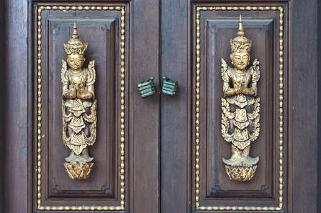 Woodcraft on wood door  photo
