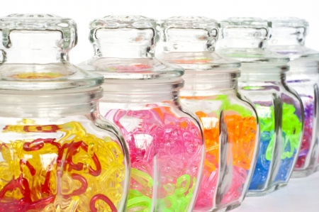 Colorful heart in glass bottles   photo