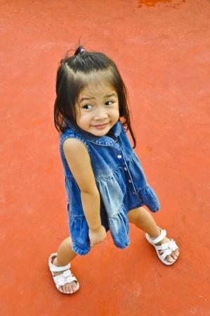 Little asian pretty girl in blue jeans  Stock Photo