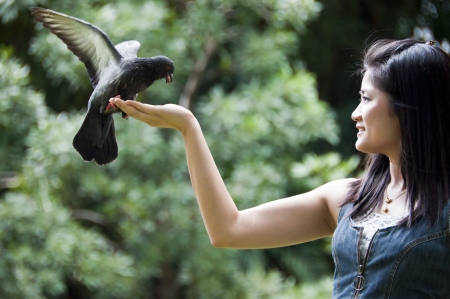 Beautiful asian woman with pigeon  photo