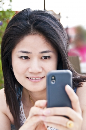 Beautiful asian woman with mobile phone