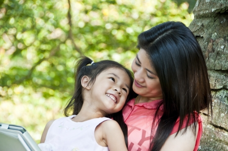 Mother and daughter enjoy their tablet PC  Stock Photo