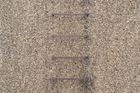 Steel ladder in gravel wall  Stock Photo - 17097486