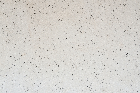 Gravel in cement on a decorative wall for a background photo