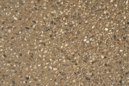 Gravel in cement on a decorative pathway for a background  photo