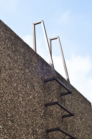Steel ladder in gravel wall  Stock Photo - 17097408