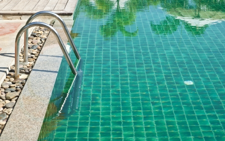 Poolside ladder  Stock Photo