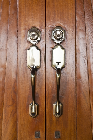 Vintage style wooden door with brass doorknob  Stock Photo - 17479254