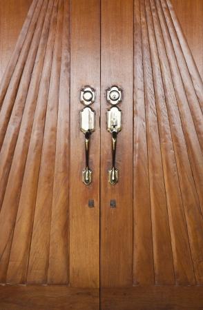 Vintage style wooden door with brass doorknob Stock Photo - 17479253