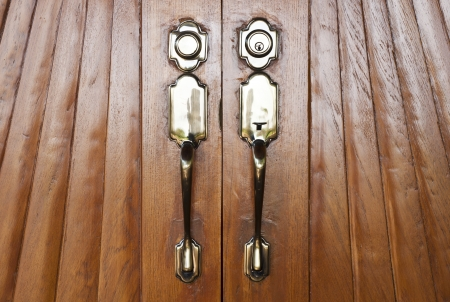 Vintage style wooden door with brass doorknob  photo