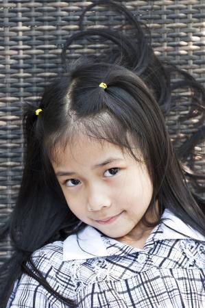 Little asian girl posing  Stock Photo - 18448481