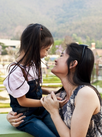 Little asian girl and mom laughing  Stock Photo