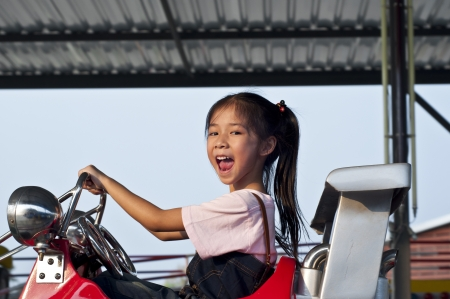 Little asian pretty girl enjoy riding  Stock Photo - 18654718
