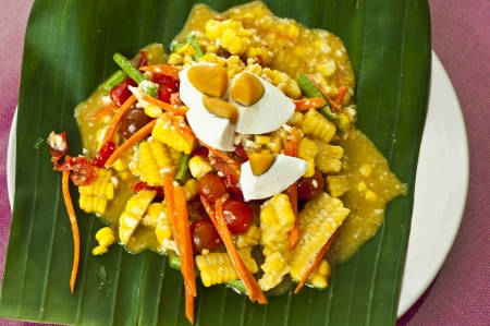 Thai style spicy corn salad with salty egg  photo