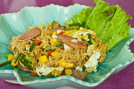Thai style stir fried noodle with sausage and vegetable