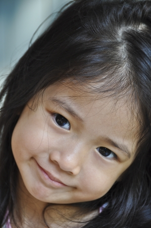 Little Asian girl smile  Stock Photo