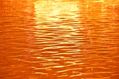 Orange water ripple as background  Stock Photo