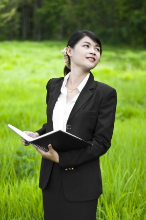 Beautiful Asian business woman, real estate investment  photo