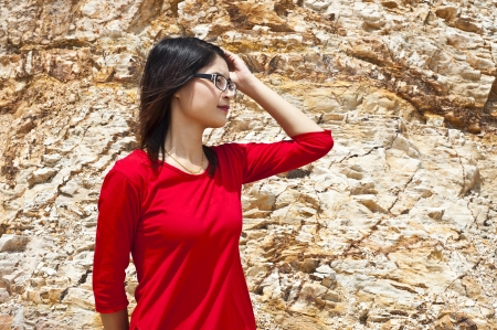 Beautiful Asian woman in red outdoor