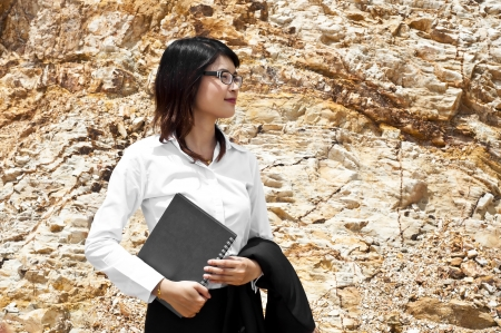 Beautiful Asian geologist woman researching in stratigraphy  Stock Photo