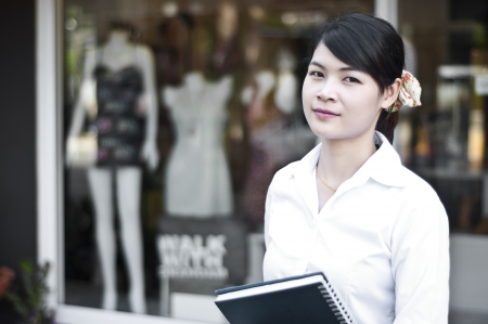 Beautiful Asian business woman in shopping mall  Stock Photo